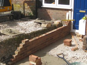 retaining wall in progress by Maintenance Matters